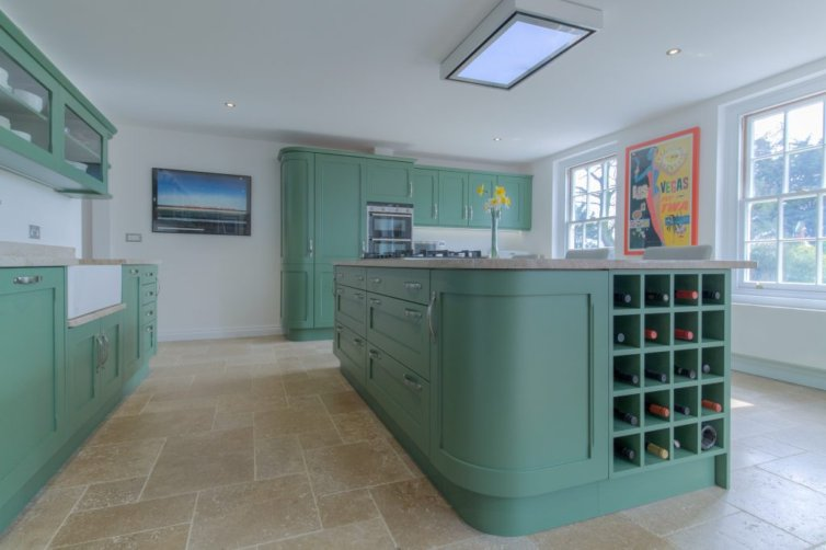 FAMILY KITCHEN IN FARROW AND BALL BREAKFAST ROOM GREEN