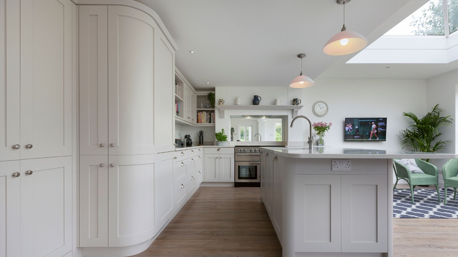 Curved cabinets in an open plan kitchen from Kestrel Kitchens